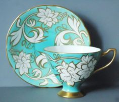Art Deo Teacups and Saucers - Vintage Tea Cup and Saucer Set - Mod Cup and Saucer Set. $40.00, via Etsy.