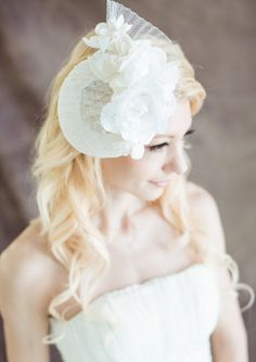 White bridal headpiece in sinamay and handmade by beingoflove