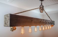 This rustic cedar beam with Edison bulbs is suspended by a barn pulley and inch rope. The beam is hand planed and sealed with the color of your choice to create a stunning focal point in your Rustic Kitchen Lighting, Modern Garage, Rustic Italian, Garage Lighting, Wall Lights, Ceiling Lights, Wall Lamps, Wood Beams, Home Decor Kitchen