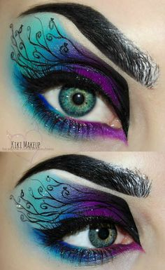 #Dramatic Makeup Vibrant Blue, Teal, and Purple Eyeshadow with Creative Eyeliner Detailing. Thick Eyebrows