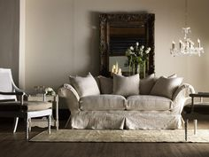 Coined in 1980 by Rachel Ashwell, this cottage-inspired look includes weathered white-painted furniture, painted motifs, floral prints in muted colors, white slipcovered sofas and vintage accessories. A sense of brightness and airiness is always evident in these interiors. Photo Courtesy of Miles Talbott's Shabby Chic® Collection.