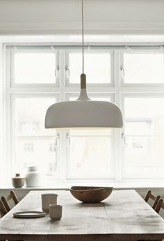 Large oversized pendant light above the dining table | Acorn, designed by Atle Tveit for Northern Lighting, is inspired by the Nordic autumn forests and the shape of the oak acorn.