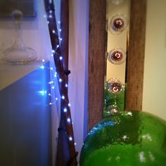 our thin wire strand lights wrapped around an antique oar...dreamy  photo Heather Ross