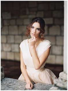 Bridal portrait at The Ancient Spanish Monastery in North Miami Beach, FL. Wedding hair and makeup by A Touch of Beauty by Lily, blush wedding dress by Chaviano Couture. Image by Simply Sarah Photography.