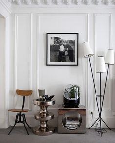 A Parisian home. The silvered ceramic Bishop Stool is by India Mahdavi - available through Ralph Pucci. The plant in a bubble is Adrea - a high tech living air filter by Mathieu Lehanneur.  Photo by Raphaël Dautigny for The Socialite Family.