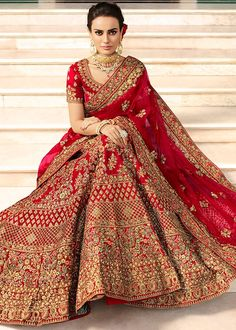 Look gorgeous in this maroon art silk bridal lehenga decked with zari, resham embroidery, lace and stone work. Paired with a matching color heavily embroidered choli and net embellished dupatta with lace details and tassels. Do Note: All Accessories shown are for styling purpose only. Slight color variation may occur due to photographic reasons. The unstitched choli size can be customized upto 44 inches.    Work : Embroidered, Zari, Resham Work, Stone    Work Color Lehenga: Maroon,    Choli…