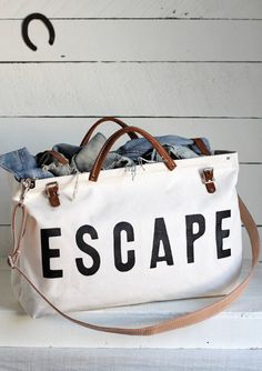 The Forestbound ESCAPE Canvas Utility Bag features sturdy black leather handles and buckle straps with metal hardware. Painted Canvas Bags, Painted Fox Home, Canvas Weekender Bag, Vegetable Leather, Travel Bags, Travel Stuff, New Bag, Black Canvas, Leather Handle