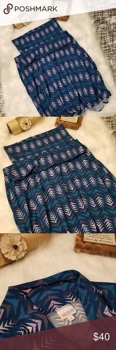 LULAROE MAXI SKIRT NWOT!! LULAROE MAXI SKIRT NWOT!! Size small but can also fit medium. No flaws, new without tags. A-line style. Navy blue with distressed arrowhead design. Pair with a navy blue or lavender blouse or tank to complete this cute outfit! Posh Ambassador, buy with confidence! Check out my other items to bundle and save on shipping! Offers accepted. I ship same or next day! LuLaRoe Skirts Maxi
