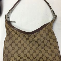 Authentic!! GUCCI HOBO BAG GUCCI limited used brown hobo bag in excellent condition. Silver hardware, perfect for everyday usage. Gucci Bags Hobos