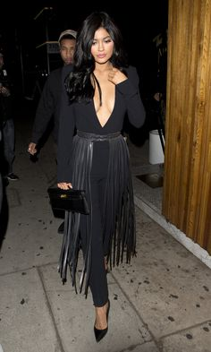 In West Hollywood, she transformed a form-fitting black jumpsuit by throwing on a waist-cinching, studded leather belt with shin-length fringe. Already being likened to a hula skirt, it costs a truly eye-watering $1,509.   - MarieClaire.com
