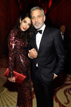 All that glitters: Amal Clooney changed into outfit number two as she partied with husband George at the Met Gala on Monday night,held at the Metropolitan Museum Of Art