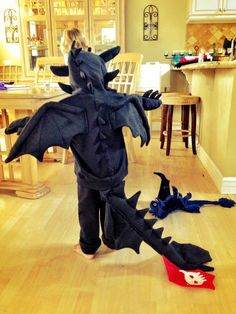 My youngest is obsessed with Toothless, from How to Train Your Dragon, so I made her this costume.