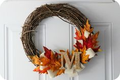 Completed pin #1: fall wreath.  This was so much fun, so cheap, and so easy!  It cost me less than $20 for the wreath, the leaves, the monogram, the glitter for the monogram, and the fabric. 10/10