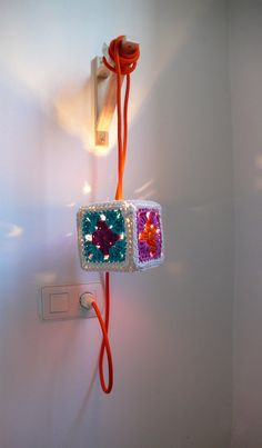 Pendant lamp with Granny Square Crochet lampshade and textile cable. €59,00, via Etsy.