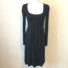 Narciso Rodriguez Black Dress Narciso Rodriguez long sleeved black dress with empire waist, scoop neck, and exposed back zipper. 95% rayon, 5% other fibers. Great condition! Narciso Rodriguez Dresses Long Sleeve
