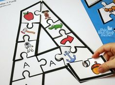 practicing letter sounds with alphabet puzzles