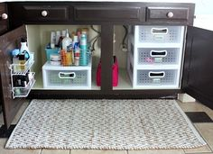 this is similar to how my cabinet looks. I stacked Sterile Shoe boxes to make the drawer tower. It stores our skin products (lotions, sunscreen, powder...)