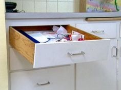 Watch HGTV's Help Around The House as expert hosts teach us the easy professional solution for fixing a sagging kitchen drawer.