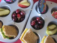 Turkey and cheese sandwiches, pickles, cherries, apple slices, and juice