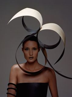 I chose this picture because of its simplistic elegance. It uses sweeping, circular lines and monochrome colours create an eye catching headdress. The white part of the headdress reminds me of an open book which gives it a papery texture. Question I have about this image is; what material was used to create the headdress and when did the designer intend someone to wear this headdress?