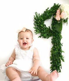 Baby girl pictures for each month.  Click to see more ideas for baby pictures with flowers #babymonthlypictures #babypictures #babygirl