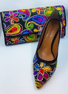 Available at Lena's Shoes and Fashions: J. Renee Shoes for Women (Camallia pumps - $99.00, Camallia clutch - $89.00)