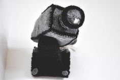 This listing is for a PDF pattern to knit a security camera. The pattern will be available for download immediately after purchase.  Sick of public surveillance? Try out the new knitcam. Completely obsolete and will not capture any images.  Knit yourself one to go in the corner of your room, or by your front door.  This pattern is for a knitted Security Camera, and includes detailed instructions and templates for making a rigid cardboard frame so the camera can be mounted on a wall…