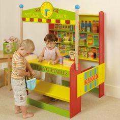 What child doesn't love playing shop keeper ? This brightly coloured village shop will keep children amused for hours. 4 Year Old Boy, Play Shop, Cubby Houses, 4 Year Olds, Imaginative Play, Old Boys, Cubbies, Wooden Toys, Toy Chest