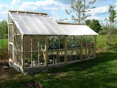 I'm really attracted to the greenhouse above. It has the feel of both greenhouse and potting shed, with a bit of chicken coop charm.  This one is made from totally recycled materials.