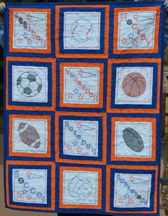 Cross Stitched Sports Baby Quilt by InnovativeCreate on Etsy