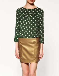 Zara seems to be the source for the polka dot blouse this season. This one has nice yoke details.