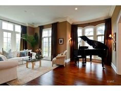 Beautiful family room with chocolate walls and grand piano...