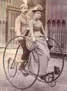 Lady-like cycling -- Early Tandem penny-farthing, which, of course, the gentleman pedaled. And doesn't she look delighted?