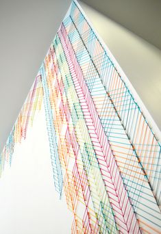 KNITTED WALL for McGarryBowen - Evelin Kasikov – CMYK embroidery and Typographic Design – London