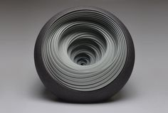 """Matthew Chambers Contemporary Ceramic Sculptures.  """"Matthew began his journey in 1993 with a training in handmade tableware with Philip Wood in Nunney, the Somerset village where he grew up. His other education began in 1999 at Bath School of Art, followed with an MA at the Royal College of Art in London from 2002. He currently lives and makes on the Isle of Wight after moving there on a residency at Quay Arts in 2004.""""  See too Ford/Forlano """"O'Keeffe"""" brooches."""