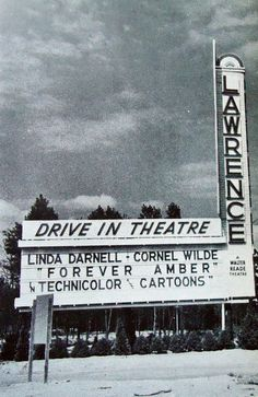 Sign for up coming movie at your local drive in theatre!