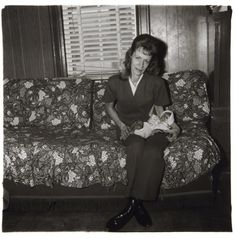 PHILLIPS : NY040212, Diane Arbus, A woman with her baby monkey, N.J.