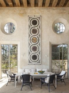 A Moroccan-style courtyard, thick plaster walls, and a Cosmati-style mosaic on the dining room wall create the mood