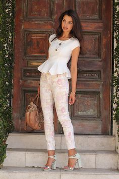 Love this structured peplum top paired with pretty floral pants.