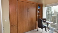 Full size wall bed and custom Murphy table in a condominium office/guest room, with the multipurpose functionality of a fold down Murphy desk and Murphy bed. Full Size Murphy Bed, Murphy Bed Plans, Murphy Beds, Lori Walls, Murphy Table, Hidden Desk, Closet Works, Bed Hardware, Bed In Closet