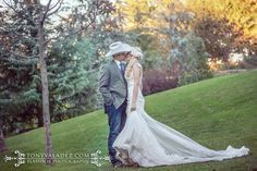 MiosaCouture Gown  low illusion back lace fit-to-flare wedding gown from Circle Park Bridal Boutique., wedding portrait at the Dallas Arboretum, cowboy hat is a nice touch