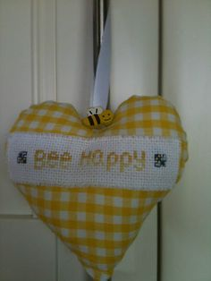 Gingham padded heart with Bee Happy cross stitched Aida panel and cute wooden bee button.  Ideal for a bee lover or bee keeper!