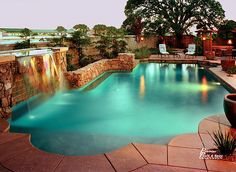 Lit pool with waterfall