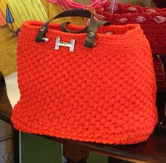 Like the Initial idea....might find one for my crocheted bag..