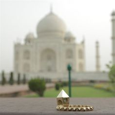 Photographer Chris Roman captures the architectural forms of Janis Savitt's gold ring and bracelet set against the shadow of the Mughal masterpiece, the Taj Mahal. Photo: Chris Roman #LoveGold #Wanderlust