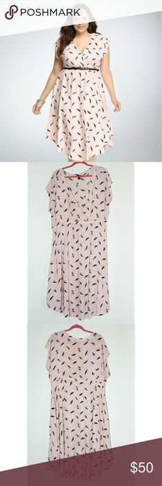 Size 3 Light Pink Feather Print Torrid Dress Sz 3 Torrid Dress. Light Pink with a white, light gray and black feather design. Only worn once. Perfect for Spring! No belt. DRESS ONLY. torrid Dresses Midi