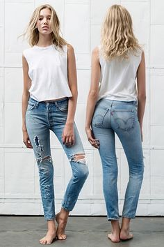 skinny shredded Levis and a white shirt