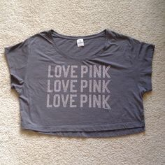 Victoria's Secret love pink Cropped gray T-shirt S Victoria's Secret love pink bling and rhinestone cropped tee shirt in gray. It is a size small. Has a great worn in feeling. Some pilling in the front but still looks great. Comes from a smoke free home Victoria's Secret Tops Crop Tops