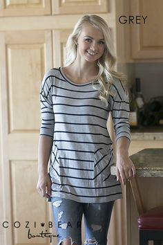 """Aren't these striped button back tunics adorable!They're super comfortable too! Pair them with your favorite leggings and heels or boots and you're set for a night out with the girls!COLORS EmeraldGreyIvoryMochaOatmealTaupeSIZES Small (4/6)Medium (8/10)Large (12/14)*Models are 5'7"""" and both wearing a size SMALLMATERIALS Rayon/Spandex/Jersey Blend"""