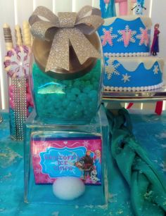 Kristoff's Ice Chips. Notice the square glass to represent his Ice Blocks. (Athena's Master Idea)   Candy: Jelly Beans